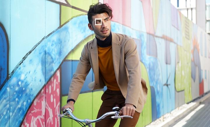Afbeelding van een man op een fiets