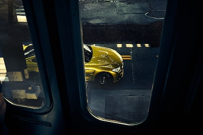 frederic-schlosser-sony-alpha-7R-yellow-car-as-seen-through-train-windows